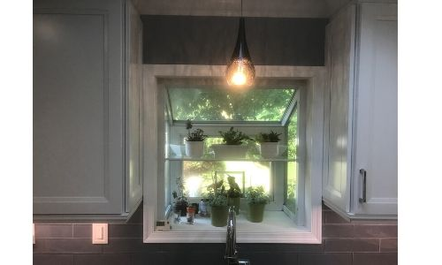 pendant lighting over a kitchen sink